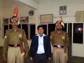 Naveen Choudhary with tall BSF man